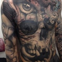 Big new school style chest and belly tattoo of human skull with dragon and eye