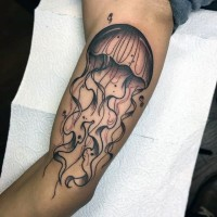 Big simple painted and colored jellyfish tattoo on arm