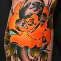 Big unusual painted colored sloth with flower tattoo on leg
