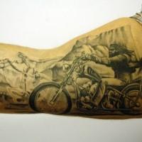 Biker and rider tattoo on arm