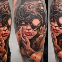 Biomechanical style colored leg tattoo of woman face with strange camera