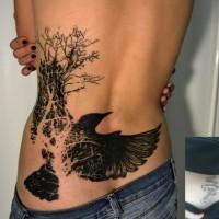 Bird tattoo on lower back