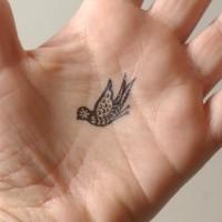 Bird tattoo on the palm