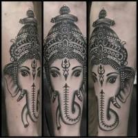 Black and gray ganesha head tattoo by Paul Aherne