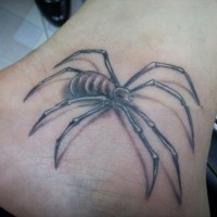 Black and gray spider tattoo on foot