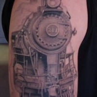 Black and gray style accurate painted upper arm tattoo of train