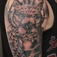 Black and gray style amazing looking shoulder tattoo of large owl