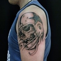 Black and gray style amazing looking shoulder tattoo of American player skeleton with helmet