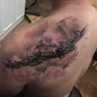 Black and gray style amazing looking scapular tattoo of big bomber plane