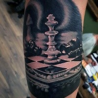 Black and gray style amazing looking biceps tattoo of chess board with figures