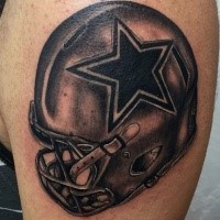 Black and gray style awesome looking shoulder tattoo of American football helmet