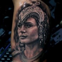 Black and gray style colored biceps tattoo of Egypt queen face