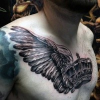 Black and gray style colored chest tattoo of crown with crow