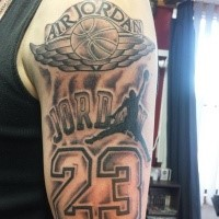 Black and gray style colored Jordan memorial tattoo on shoulder