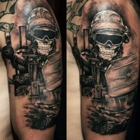 Black and gray style colored shoulder tattoo of modern military soldier with machine gun