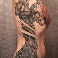 Black and gray style colored side tattoo of corrupted old tree