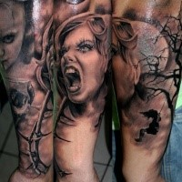 Black and gray style detailed arm tattoo of screaming woman with vine and dark tree