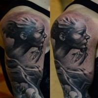 Black and gray style detailed shoulder tattoo of woman face with smoke and rose
