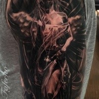 Black and gray style large shoulder tattoo of woman angel with wings