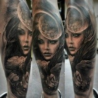 Black and gray style mystical looking leg tattoo of woman with moon
