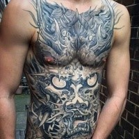 Black and gray style style large whole chest tattoo of fantasy dragon