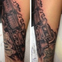 Black and gray style train with lettering tattoo on arm