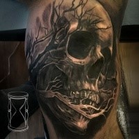 Black and gray style very detailed biceps tattoo of human skull with tree