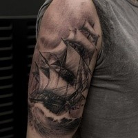 Black and gray style very detailed shoulder tattoo of breathtaking sailing ship