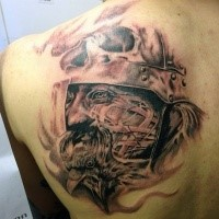 Black and grays tyle awesome looking scapular tattoo of creepy warrior