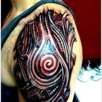 Black and red biomechanical tattoo on shoulder