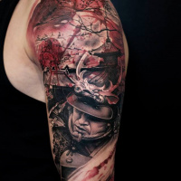 Black and red samurai tattoo on shoulder
