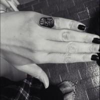 Black and white Darth Vader's helmet tattoo on little finger