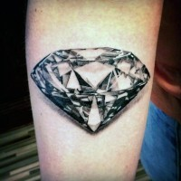 Black and white detailed diamond tattoo