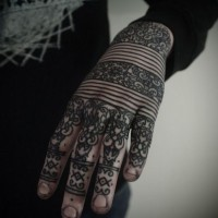 Black and white Henna style pattern tattoo with lines on hand