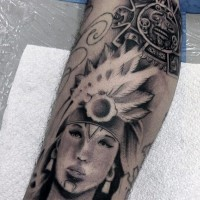Black and white leg tattoo of Indian woman portrait combined with tribal tablet