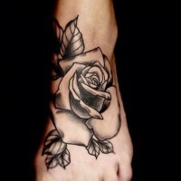 Black and white massive rose flower tattoo on foot