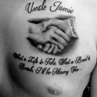 Black and white scapular memorial tattoo of lettering with hand shake