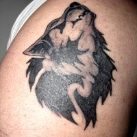 Black and white shoulder tattoo of werewolf