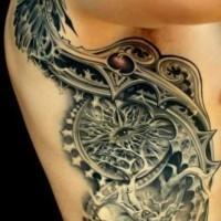Black biomechanisms tattoo on ribs