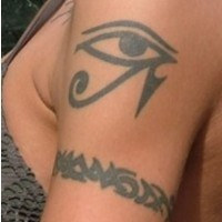 Black egyptian eye tattoo on shoulder