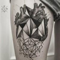 Black geometric heart tattoo on thigh