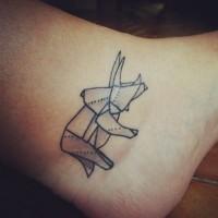Black geometric rhino tattoo on leg