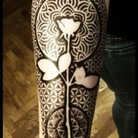 Black geometric rose tattoo on hand