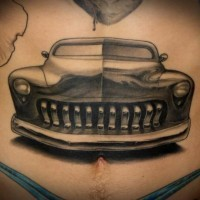 Black gray car tattoo on stomach