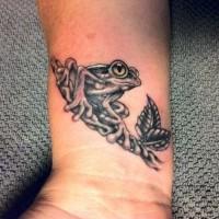 Black gray frog tattoo on wrist