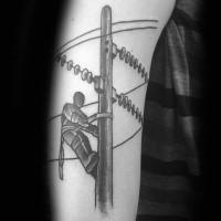 Black ink amazing arm tattoo of lineman