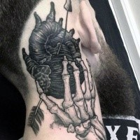 Black ink amazing looking neck tattoo of skeleton hand holding human heart with arrow