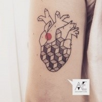 Black ink arm tattoo of human heart with geometrical figures