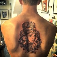 Black ink back tattoo of Egypt woman with crown