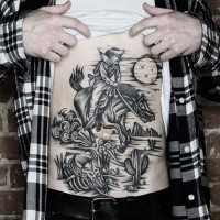 Black ink belly tattoo f western cowboy horse rider in desert